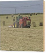 Tractor Bailing Hay In A Field At Harvest Time Pt Wood Print