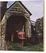 Tractor Parked Inside Of A Round Barn Wood Print