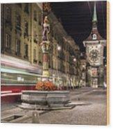 Tram Rushes In The Street Of Bern Wood Print