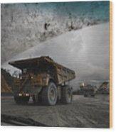 Trucks Hauling Waste Rock At Batu Wood Print by Randy Olson