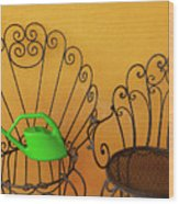 Two Black Iron Chairs And A Green Watering-can  Laid  On The Big Wood Print