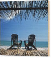 Two Chairs On Deck By Ocean Shaded By Wood Print