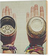 Two Hands Holding And Showing Both Sides Of Decorated Tibetan Singing Bowls Wood Print