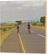 Two Men Riding Bicycle In Tanzania Wood Print