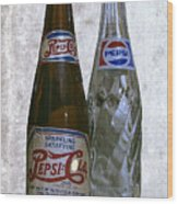Two Pepsi Bottles On A Table Wood Print by Daniel Hagerman