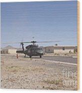 Uh-60 Black Hawk Helicopter Lands Wood Print