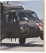 Uh-60 Black Hawk Refuels Wood Print
