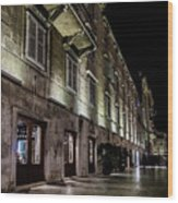 Up Lighting On A European Building At Night  Wood Print