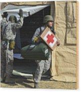 U.s. Air Force Soldier Exits A Medical Wood Print