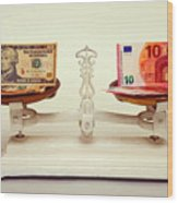 U.s. Dollar And Euro Banknotes On A Pair Of Scales In Vienna Wood Print