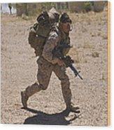 U.s. Marine Runs To The Uh-60 Black Wood Print