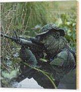 U.s. Navy Seal Crosses Through A Stream Wood Print