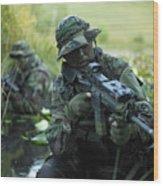 U.s. Navy Seals Cross Through A Stream Wood Print