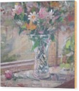 Vase And Flowers In Window Sill. Wood Print
