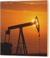 Vertical Oil Rig Sunset Wood Print by Connie Cooper-Edwards