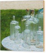 Vintage Glass Bottles On Table Wood Print