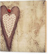 Vintage Handmade Plush Heart Pillow On The Soft Blanket Wood Print
