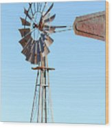 Water Pump Windmill On Blue Sky Background Wood Print