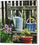 Watering Can And Blue Basket Wood Print