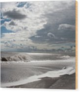 Waves Breaking Against The Beach And Cloud Streaming Above  Skegness Lincolnshire England Wood Print