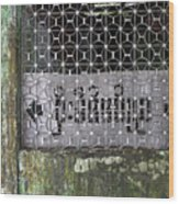Weathered Green Concrete Doorway With Grille And Obscured Sign P Wood Print