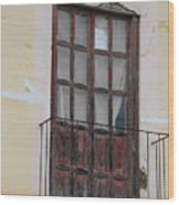 Weathered Red Door On A Balcony Wood Print