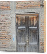 Weathered Wood Door In An Adobe Brick Wall Wood Print