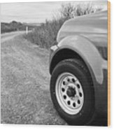 Wheel Of Small 4x4 Vehicle Driving On Gravel Road Onto Main Road Reykjavik Iceland Wood Print