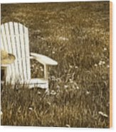 White Chair With Straw Hat In A Field Wood Print