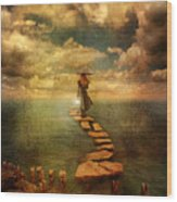 Woman Crossing The Sea On Stepping Stones Wood Print by Jill Battaglia