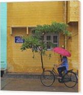 Woman Cycling In Street Wood Print