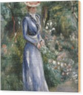 Woman In A Blue Dress Standing In The Garden At Saint-cloud Wood Print by Pierre Auguste Renoir