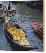 Woman In Banana Boat Wood Print