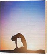Woman In Camel Yoga Pose Meditating At Sunset Wood Print