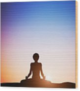 Woman In Lotus Yoga Pose Meditating At Sunset Wood Print