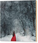 Woman In Red Cape Walking In Snowy Woods Wood Print