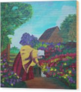 Woman In The Garden Wood Print
