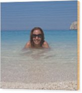 Woman In Water Enjoying Navagio Beach On The Island Of Zakinthos Wood Print