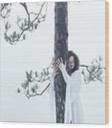 Woman In White Dress Hugging A Tree Wood Print