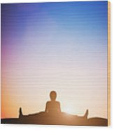 Woman In Wide Angle Bend Yoga Pose Meditating At Sunset Wood Print