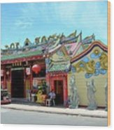 Woman Sits Outside Chinese Temple With Urn And Deity Statues Pattani Thailand Wood Print