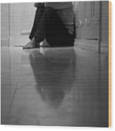 Woman Sitting In Corridor With Head In Hands Wood Print by Sami Sarkis