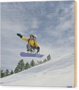 Woman Snowboarding On The Cinder Cone Wood Print by Kate Thompson
