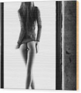 Woman standing in doorway Wood Print