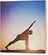 Woman Standing In Revolved Side Angle Yoga Pose Meditating At Sunset Wood Print