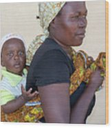 Woman With A Baby In Tanzania Wood Print