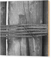 Wood Pilings Tied With Old Rusted Rope Wood Print