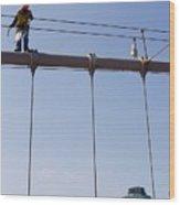 Worker On Top Of Brooklyn Bridge In New York City Wood Print
