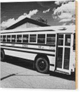 yellow american bluebird school bus in Lynchburg tennessee usa Wood Print by Joe Fox