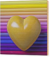 Yellow Heart On Row Of Colored Pencils Wood Print by Garry Gay